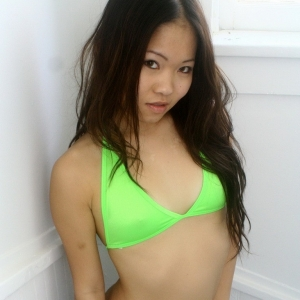 Kates cute little girlfriend Grace teases in her neon green string bikini