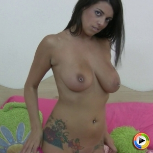 Watch busty babe Ela Stone slowly strip naked as she encourages you to jerk off to her