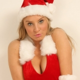 Merry Christmas from Kates sexy girlfriend Lisa as she strips out of her little Santa outfit