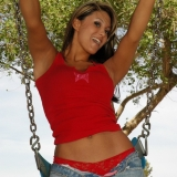 Kates cute girlfriend Rio has a little fun at the playground in her tight jeans with red lace panties underneath