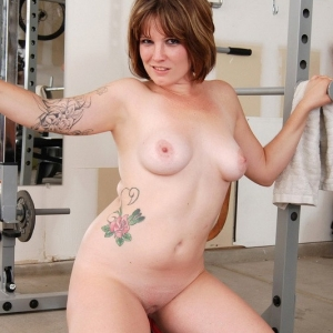 Curvy Spunky Angels babe Misty strips naked in the gym as cools off from her workout