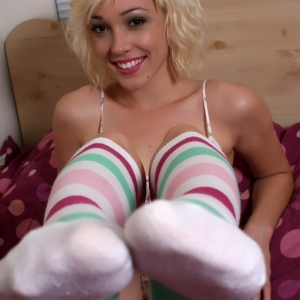 Sexy blonde tease Lily Labeau strips down to just her striped knee high socks