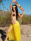 Stunning tease Tianna shows off her tight body in her skimpy hula outfit outdoors