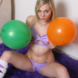 Perky blonde Samantha shows off her perfect body as she teases in her shiny skimpy outfit and balloons