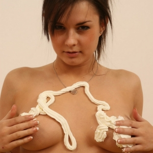 Kates perfect stunning girlfriend Alicia strips out of her string bikini and covers her perky tits with whipped cream