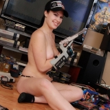 Perky tease Emily Love shows off her geek side as she plays a few games on the retro Nintendo as she gets naked