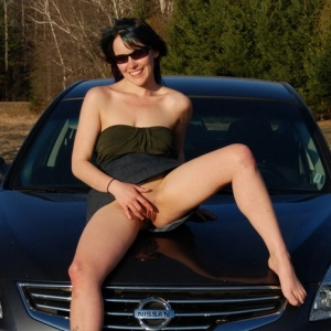 Horny tease Sabrina shows off her tight pussy as she lifts her dress while on the hood of the car outdoors in the warm sun