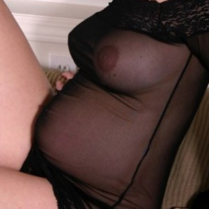 Pregnant Teen showing all in her black sheer dress