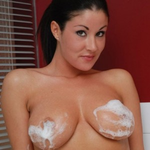 Krissy gets naked and soapy in the bathtub