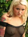 Jeskas rock hard nipples are poking through her mesh dress