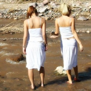 The Girls Taking A Dip in the River