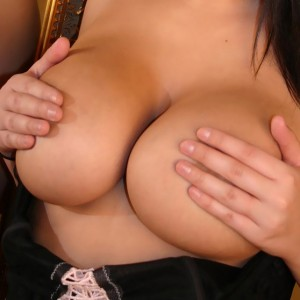 Busty Southern Brooke loves to tease with her huge natural breasts in her tight black corset