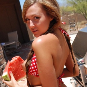 Country girl Craving Carmen makes a mess with her juicy watermelon in a tiny checkered string bikini and tiny jean shorts
