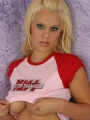 Blonde Jenny loves to tease as she keeps her big tits barely hidden by her KISS concert shirt