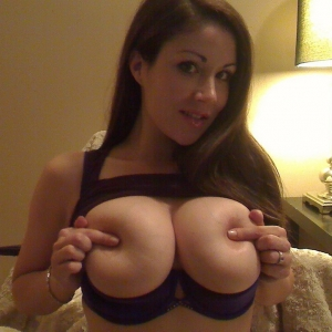 Sweet Krissy loves to tease with her big juicy tits and tight round ass in a matching purple bra and panties
