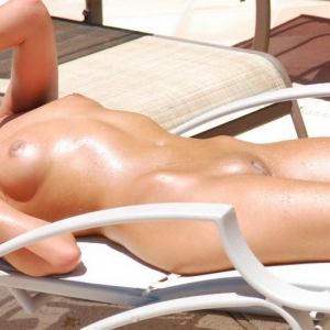 Craving Carmen Nude: Beautiful babe Craving Carmen tans nude outdoors in the hot sun