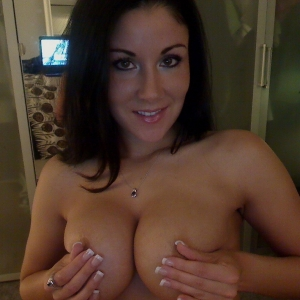 Busty babe Krissy teases with her big juicy tits when she strips out of her black lace bra