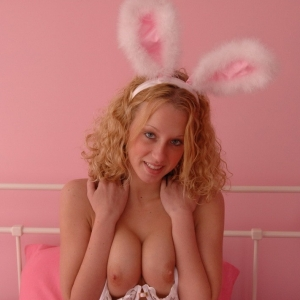 Busty blonde Lucky dresses up as a slutty bunny for Easter and shows off her big natural teenage breasts