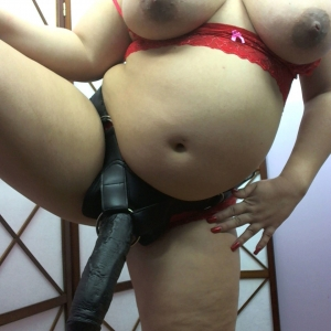 Pregnant and horny porn star Georgia Peach shows off her new big black strap-on and her huge tits