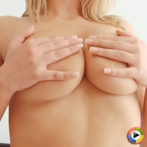 Watch as busty blonde Millie Fenton teases with her big juicy tits as she strips naked