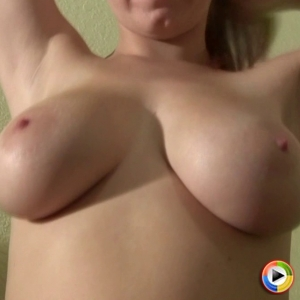 Watch as busty blonde babe Ami Jordan teases and plays with her huge juicy tits