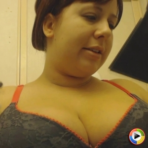 Pregnant pornstar Georgia Peach shows off her big tits in her grey bra as she does her makeup