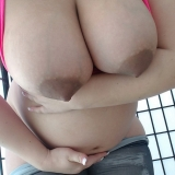 Knocked up pornstar Georgia Peach shows off her big swollen belly and huge tits as she strips out of her hot pink top